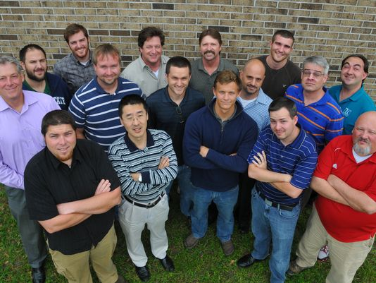 16 members of TLC Engineering group shot from above (Photo: MALCOLM DENEMARK/FLORIDA TODAY)