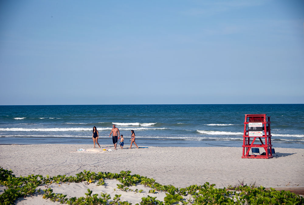 A family enjoys a beautiful day at Fisher Park in Cocoa Beach.