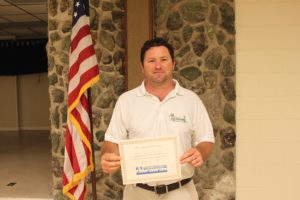 Jeff Daniels of Greenwing Lawn & Pest services receives his certification.