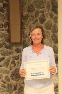Shelly McKinney of Gardens By Shelly receives her certification.